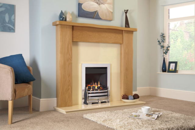 wooden fireplace and gas fire