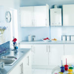 white and blue kitchen with worcester boiler